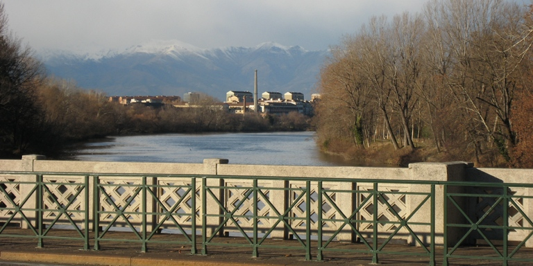 Picture taken from Ponte di Sassi in Torino with the Alps in the background