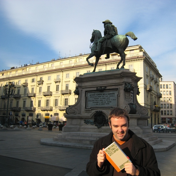 Picture of me holding the Green Marketing Manifesto in Piazza Bodoni