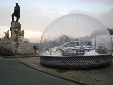 Photo of a car trapped in a bubble with artificial snow